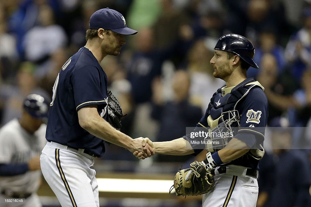 <a gi-track='captionPersonalityLinkClicked' href=/galleries/search?phrase=John+Axford&family=editorial&specificpeople=6825257 ng-click='$event.stopPropagation()'>John Axford</a> #59 of the Milwaukee Brewers celebrates with <a gi-track='captionPersonalityLinkClicked' href=/galleries/search?phrase=Jonathan+Lucroy&family=editorial&specificpeople=5732413 ng-click='$event.stopPropagation()'>Jonathan Lucroy</a> #20 after the 5-3 win over the San Diego Padres at Miller Park on October 1, 2012 in Milwaukee, Wisconsin.
