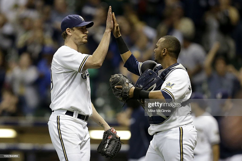 <a gi-track='captionPersonalityLinkClicked' href=/galleries/search?phrase=John+Axford&family=editorial&specificpeople=6825257 ng-click='$event.stopPropagation()'>John Axford</a> #59 of the Milwaukee Brewers celebrates with Martin Maldonado #12 during the game against the San Diego Padres at Miller Park on October 2, 2012 in Milwaukee, Wisconsin.