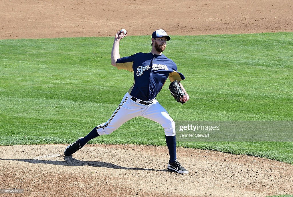 John Axford #59 of the Milwaukee Brewers pitches in the spring training game against the Oakland Athletics at Maryvale Baseball Park on February 23, 2013 in Phoenix, Arizona.