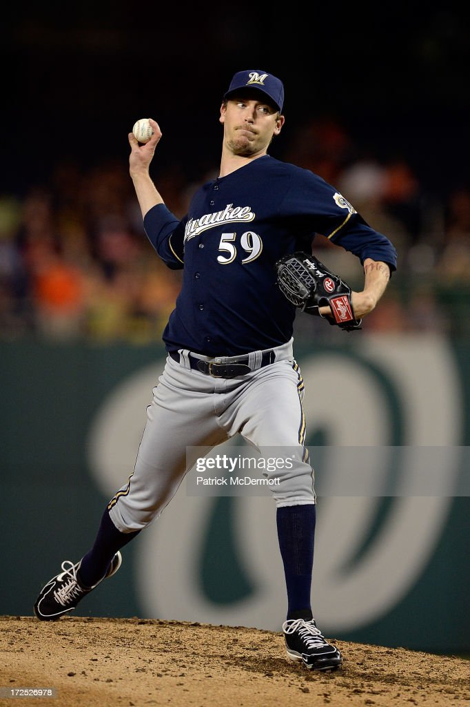 <a gi-track='captionPersonalityLinkClicked' href=/galleries/search?phrase=John+Axford&family=editorial&specificpeople=6825257 ng-click='$event.stopPropagation()'>John Axford</a> #59 of the Milwaukee Brewers throws a pitch in the sixth inning during a game against the Washington Nationals at Nationals Park on July 2, 2013 in Washington, DC.