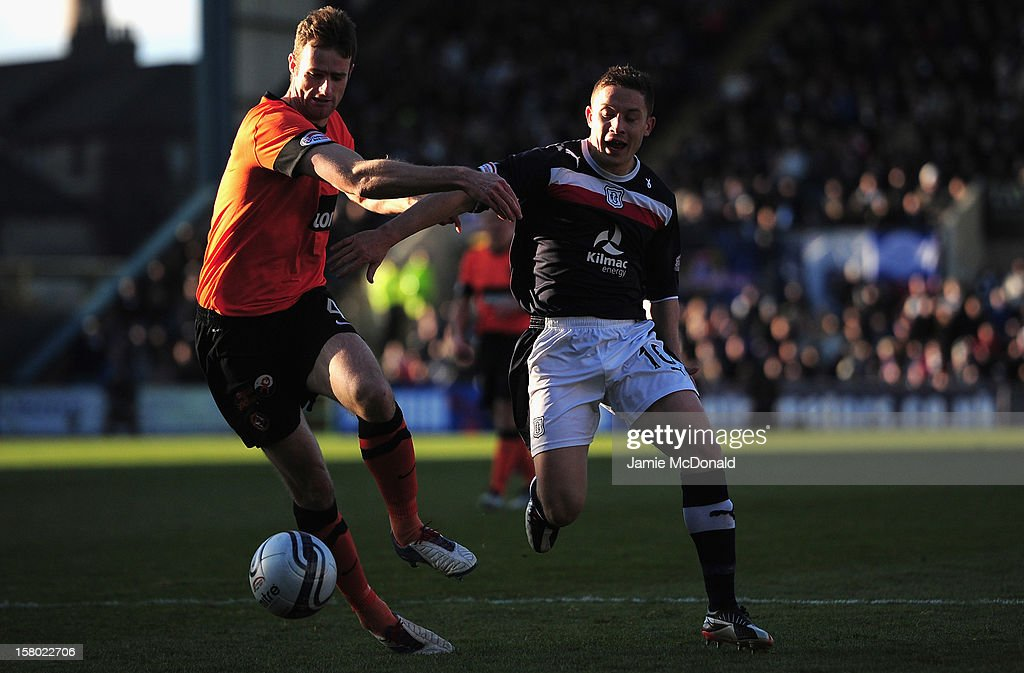 John Baird of Dundee battles with Brian McLean of Dundee United during the Clydesdale Bank Premier League match between Dundee and Dundee United at Dens Park Stadium on December 9, 2012 in Dundee, Scotland.