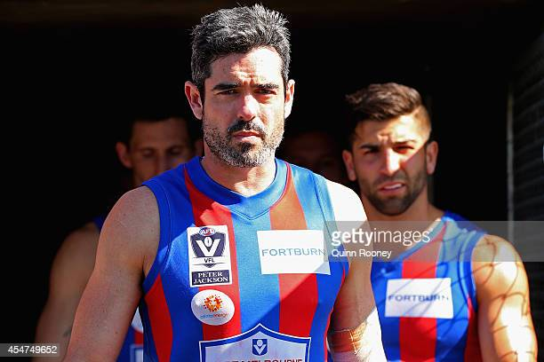 John Baird of Port Melbourne leads his team out onto the field during the VFL Semi Final match between Port Melbourne and Sandringham at North Port...