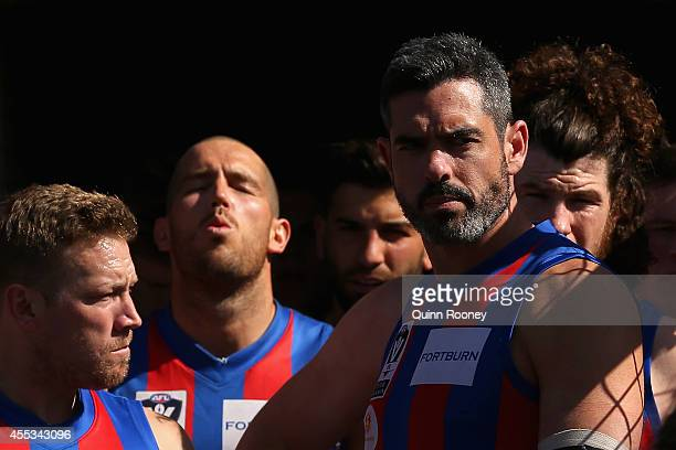 John Baird of Port Melbourne leads his team out onto the field during the VFL Preliminary Final match between the Footscray Bulldogs and Port...