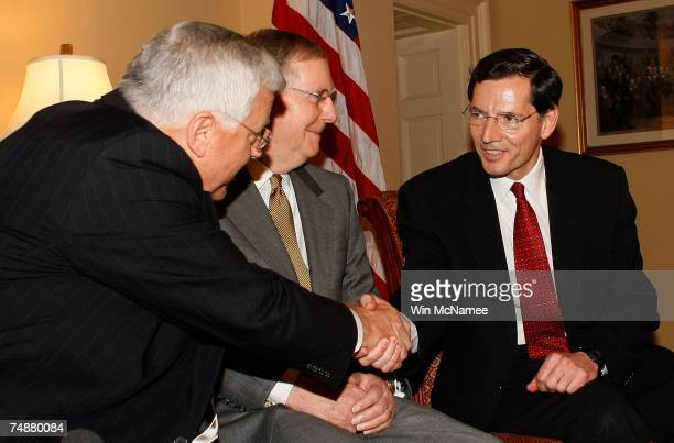 John Barasso the newly appointed US senator from Wyoming shakes hands with Sen Mike Enzi in the office of Sen Mitch McConnell during a meeting at the...