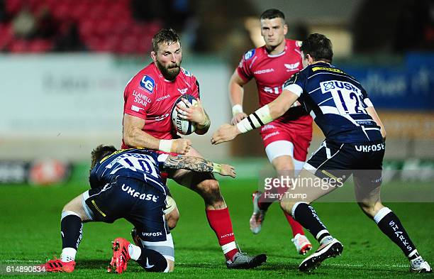 John Barclay of Scarlets is tackled by Dan Mugford of Sale Sharks during the European Rugby Champions Cup between Scarlets and Sale Sharks at Parc y...