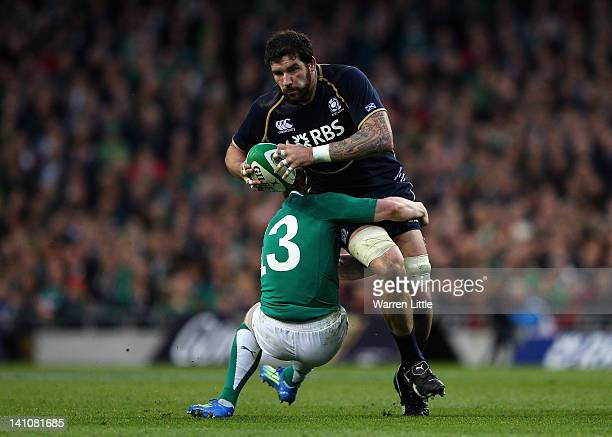 John Barclay of Scotland is tackled by Keith Earls of Ireland during the RBS Six Nations match between Ireland and Scotland at Aviva Stadium on March...