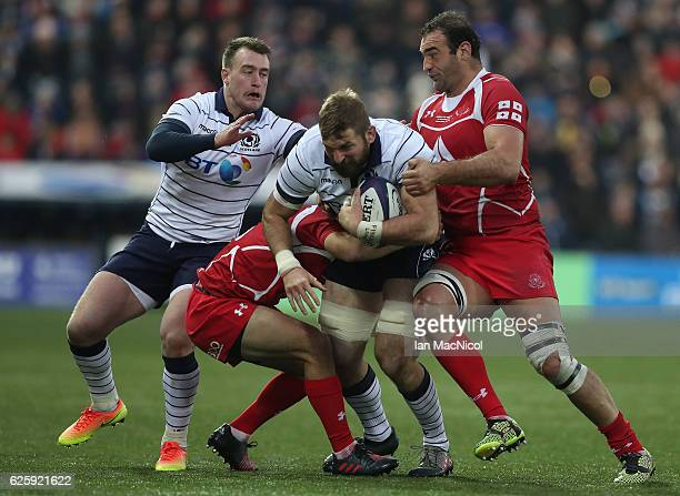 John Barclay of Scotland is tackled by Mamuka Gorgodze of Georgia during the Autumn Test Match between Scotland and Georgia at Rugby Park on November...