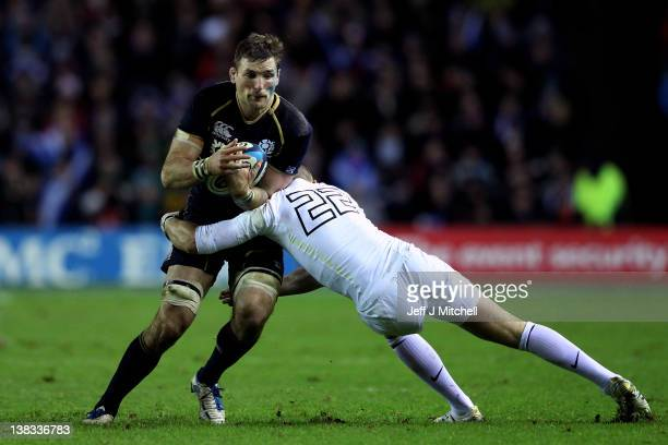 John Barclay of Scotland is tackled by Mike Brown of England during the RBS Six Nations match between Scotland and England at Murrayfield Stadium on...