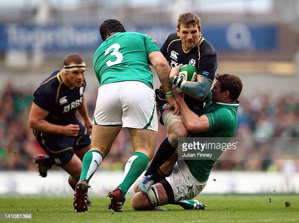John Barclay of Scotland is tackled by the Irish defence during the RBS Six Nations match between Ireland and Scotland at Aviva Stadium on March 10...