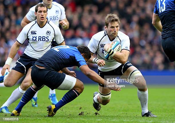 John Barclay of Scotland is tackled by Wesley Fofana of France during the RBS Six Nations match between Scotland and France at Murrayfield Stadium on...