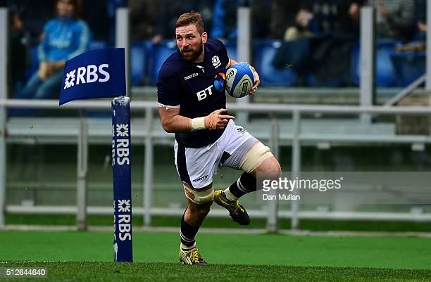 John Barclay of Scotland runs in for his side's opening try during the RBS Six Nations match between Italy and Scotland at Stadio Olimpico on...