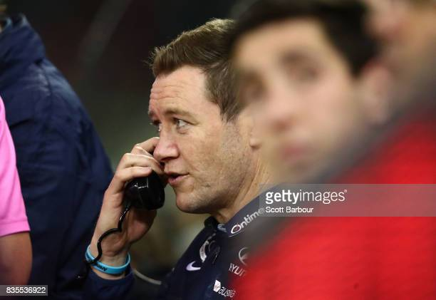 John Barker Stoppages Coach of the Blues speaks on the phone during the round 22 AFL match between the Carlton Blues and the Hawthorn Hawks at Etihad...