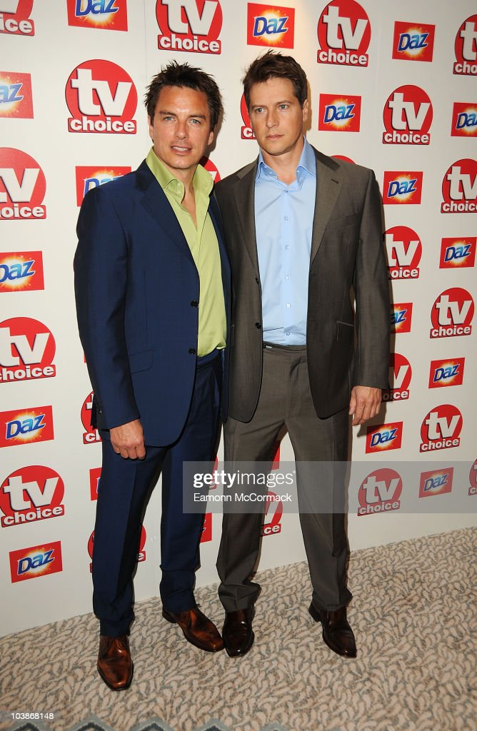 John Barrowman (L) and Scott Gill arrive at the TVChoice Awards 2010 held at The Dorchester on September 6, 2010 in London, England.