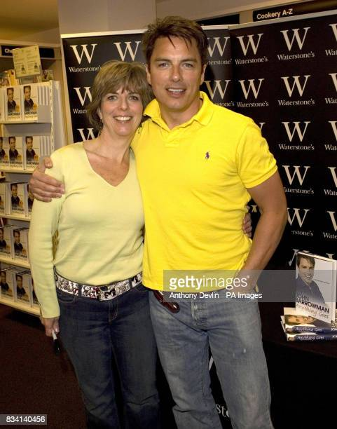 John Barrowman signs copies of his autobiography with sister and cowriter Carole Barrowman at Waterstones on Oxford Street in central London