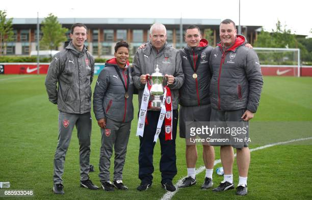 John Bayer head coach of Arsenal Ladies with his backroom staff and the trophy after winning the FA Girls' Youth Cup Final between Millwall Lionesses...