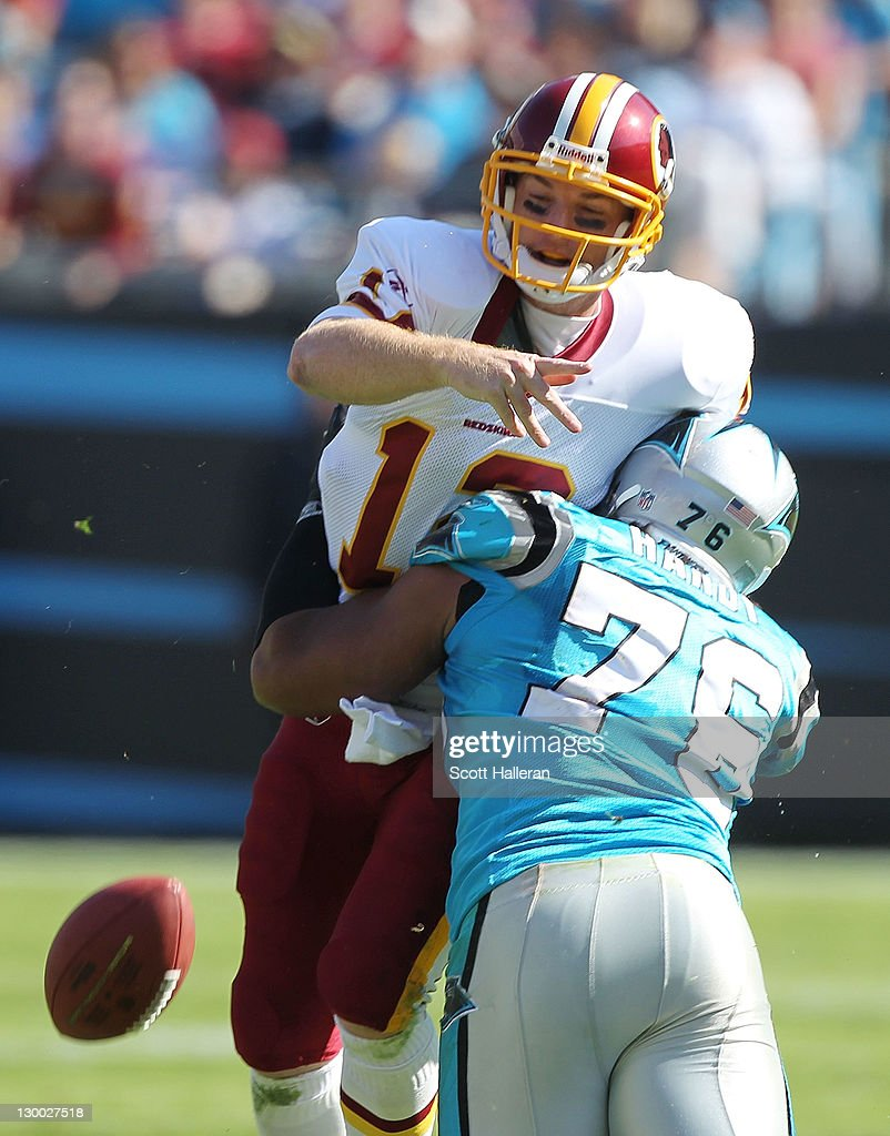 <a gi-track='captionPersonalityLinkClicked' href=/galleries/search?phrase=John+Beck&family=editorial&specificpeople=1708750 ng-click='$event.stopPropagation()'>John Beck</a> #12 of the Washington Redskins is sacked by Greg Hardy #76 of the Carolina Panthers during their game at Bank of America Stadium on October 23, 2011 in Charlotte, North Carolina.