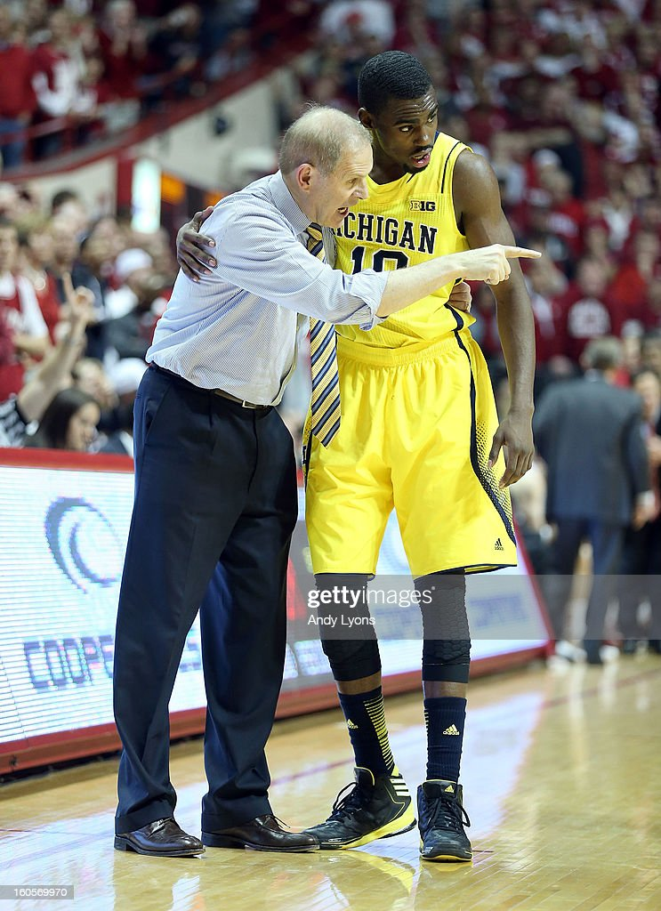 <a gi-track='captionPersonalityLinkClicked' href=/galleries/search?phrase=John+Beilein&family=editorial&specificpeople=233435 ng-click='$event.stopPropagation()'>John Beilein</a> the head coach of the Michigan Wolverines talks with Tim Hardaway Jr #10 during the game against the Indiana Hoosiers at Assembly Hall on February 2, 2013 in Bloomington, Indiana.