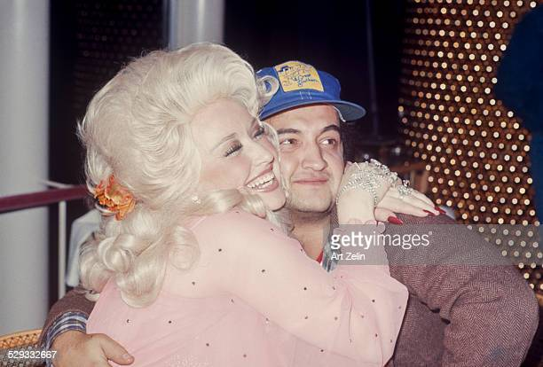 John Belushi hugged by Dolly Parton circa 1970 New York