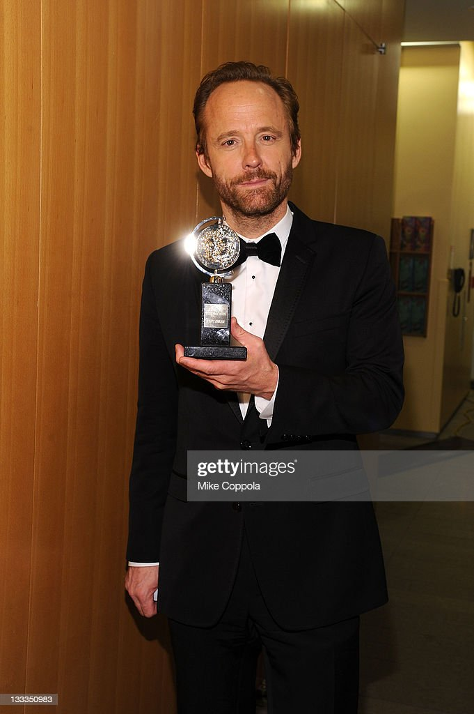 John Benjamin Hickey poses with the award for Best Performance by an Actor in a Featured Role in a Play during the 65th Annual Tony Awards at the The Jewish Community Center in Manhattan on June 12, 2011 in New York City.