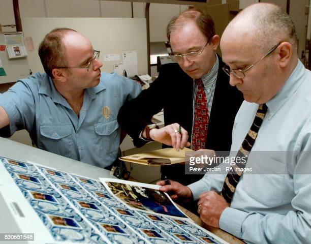 John Bennet a machine minder Graham Tapp security print buyer from Crown Agents Stamp Bereau and David Hurley operations director check the new Royal...