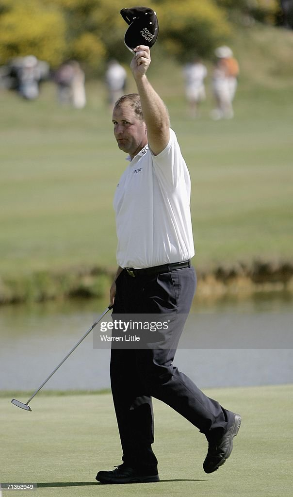John Bickerton of England acknowledges the crowd on the 18th green after winning the 2006 Open de France presented by Alstom by one shot on a score...