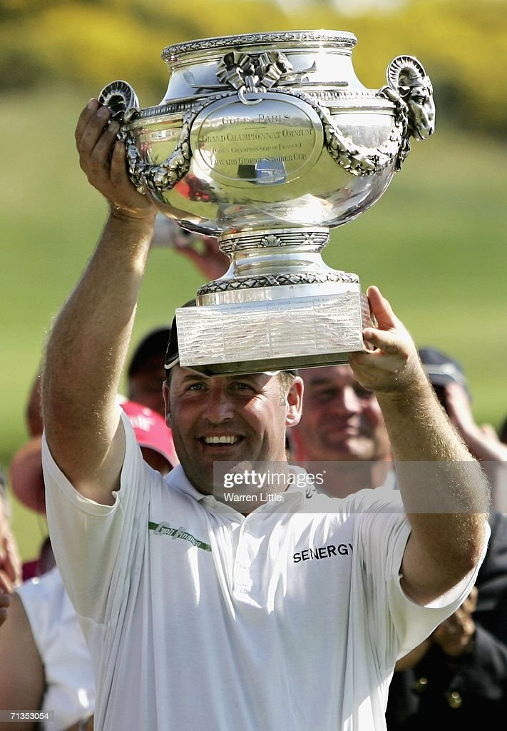 John Bickerton of England lifts the trophy after winning the 2006 Open de France presented by Alstom by one shot on a score of 11 under parat Golf...