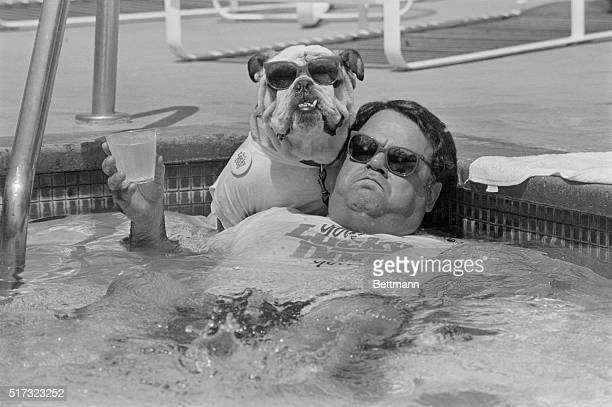 John Bisciglia relaxes with Ike his English bulldog in a pool The pair was chosen to represent the Lucky Dog LookAlike Contest in which the winning...