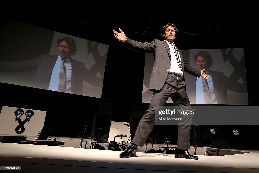 John Bishop on the catwalk during One For The Boys Fashion Ball hosted by Samuel L. Jackson, uniting men against cancer to kick start London Collections Men at The Roundhouse on June 12, 2015 in London, England.