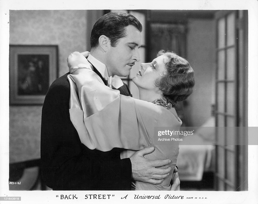 John Boles and Irene Dunn embracing in a scene from the film 'Back Street' 1932