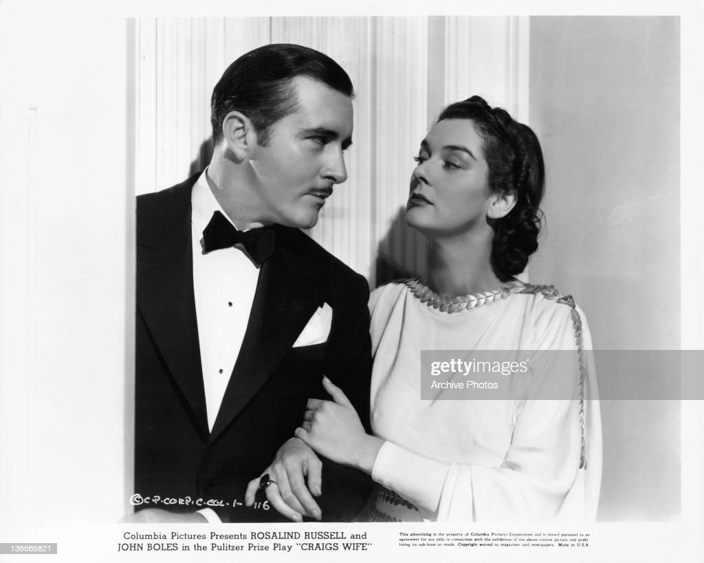 John Boles is held by Rosalind Russell in a scene from the film 'Craig's Wife' 1936