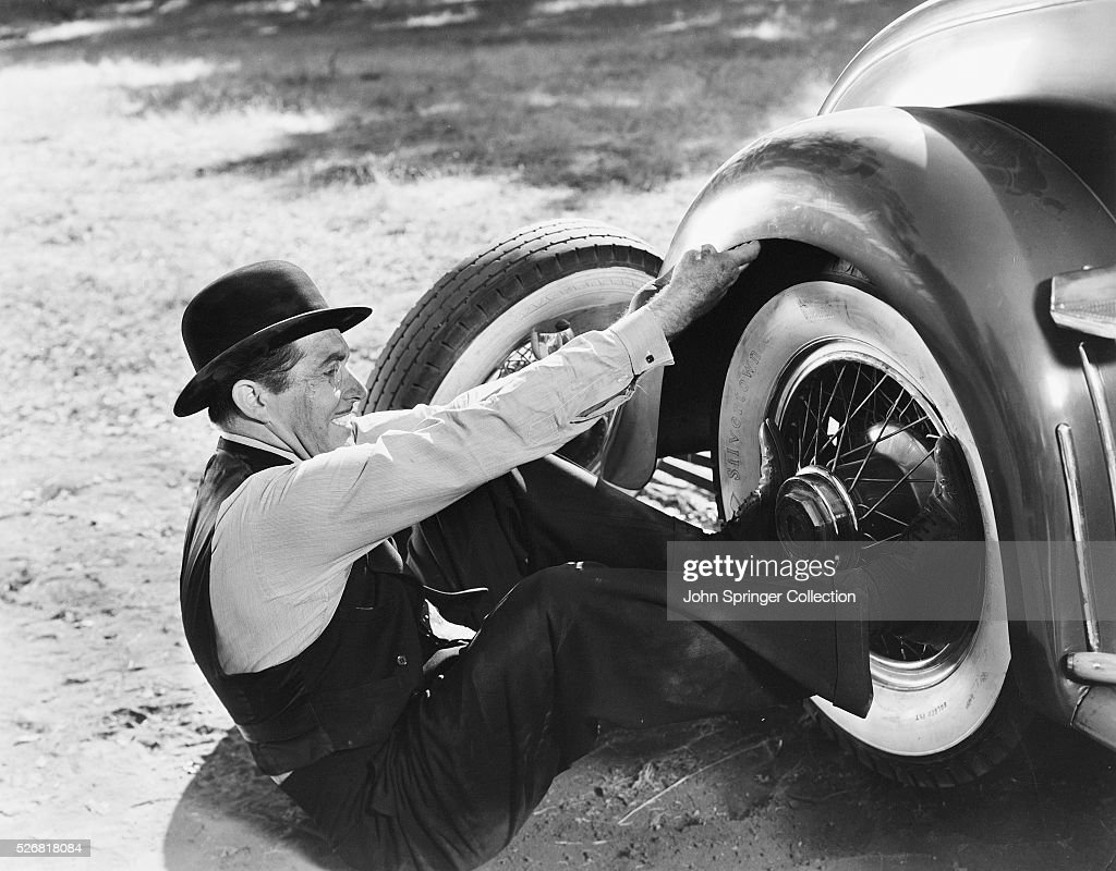 John Boles playing Antal Kovach fixes a fender in Romance in the Dark