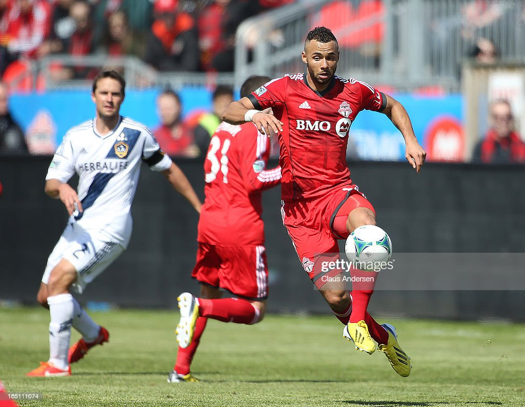 John Bostock #7 of Toronto FC grabs a ball in an MLS game against the Los Angeles Galaxy on March 30, 2013 at BMO Field in Toronto, Ontario, Canada.