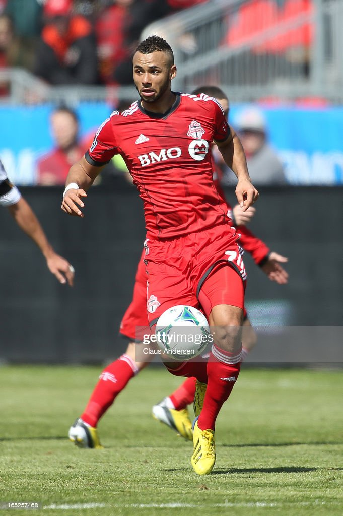 John Bostock #7 of Toronto FC plays in an MLS game against the LA Galaxy on March 30, 2013 at BMO field in Toronto, Ontario, Canada. The LA Galaxy and the Toronto FC played to a 2-2 tie.