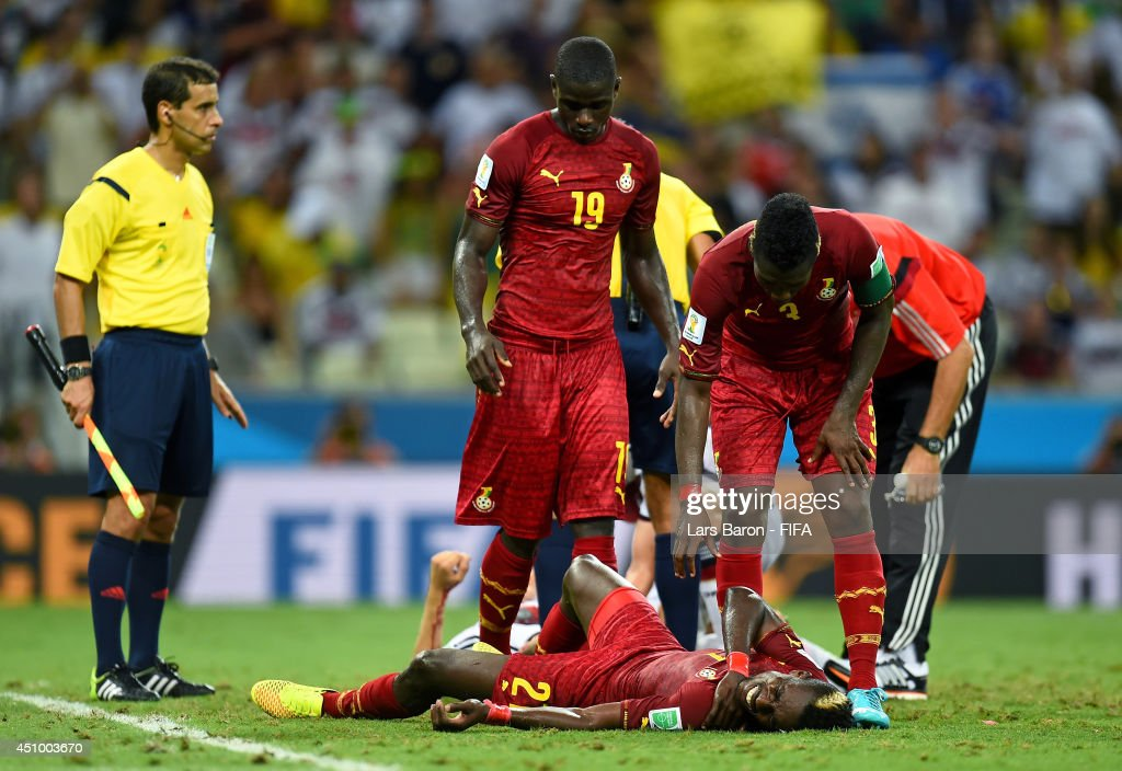 <a gi-track='captionPersonalityLinkClicked' href=/galleries/search?phrase=John+Boye&family=editorial&specificpeople=7190220 ng-click='$event.stopPropagation()'>John Boye</a> of Ghana lies injured after colliding with Thomas Mueller of Germany during the 2014 FIFA World Cup Brazil Group G match between Germany and Ghana at Castelao on June 21, 2014 in Fortaleza, Brazil.