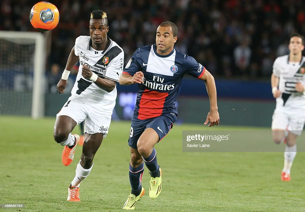 <a gi-track='captionPersonalityLinkClicked' href=/galleries/search?phrase=John+Boye&family=editorial&specificpeople=7190220 ng-click='$event.stopPropagation()'>John Boye</a> of Stade Rennais FC and <a gi-track='captionPersonalityLinkClicked' href=/galleries/search?phrase=Lucas+Moura+-+Soccer+Midfielder+-+Born+1992&family=editorial&specificpeople=7910925 ng-click='$event.stopPropagation()'>Lucas Moura</a> of Paris Saint-Germain during the French Ligue 1 between Paris Saint-Germain FC and Stade Rennais FC at Parc Des Princes on May 07, 2014 in Paris, France.