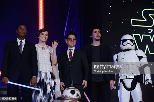 John Boyega Daisy Ridley JJ Abrams BB8 Adam Driver and Stormtrooper attend the 'Star Wars The Force Awakens' fan event at the Roppongi Hills on...