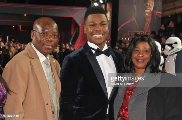 John Boyega poses with parent Samson Boyega and Abigail Boyega at the European Premiere of 'Star Wars The Last Jedi' at the Royal Albert Hall on...