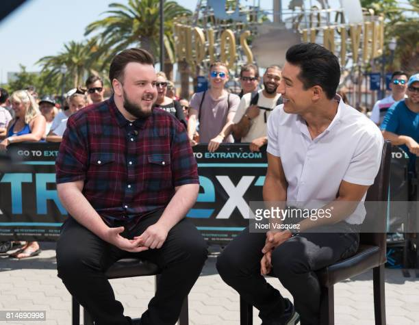 John Bradley and Mario Lopez visit 'Extra' at Universal Studios Hollywood on July 14 2017 in Universal City California