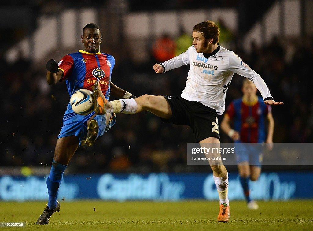 John Brayford of Derby County battles with Yannick Bolaise of Crystal Palace during the npower Championship match between Derby County and Crystal Palace at Pride Park Stadium on March 1, 2013 in Derby, England.