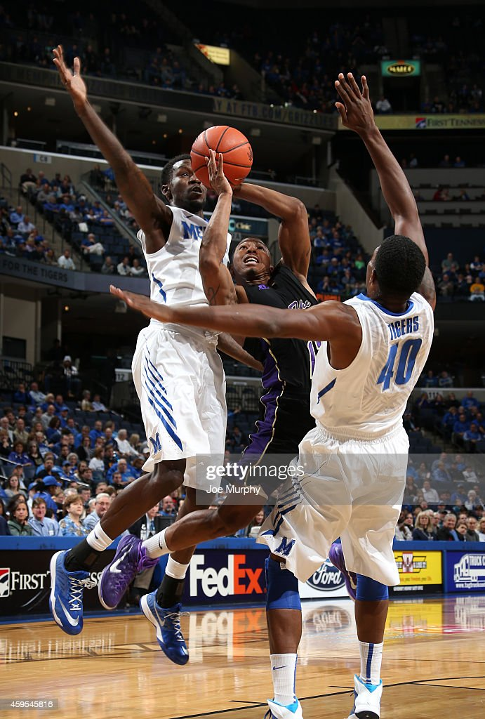 John Brisco of the Prairie View AM Panthers drives to the basket against Calvin Godfrey and Trahson Burrell of the Memphis Tigers on November 24 2014...