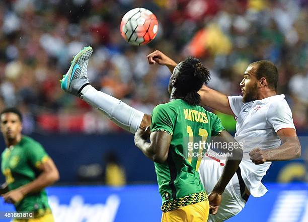 John Brooks of he US kicks the ball in front of Jamaica's Darren Mattocks during a CONCACAF Gold Cup semifinal football match in Atlanta on July 22...