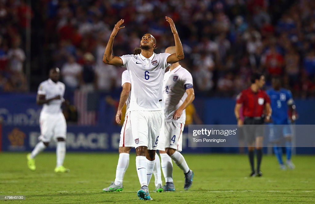 John Brooks of USA celerates after Clint Dempsey of USA scored against Donis Escober of Honduras during the 2015 CONCACAF Gold Cup Group A match...