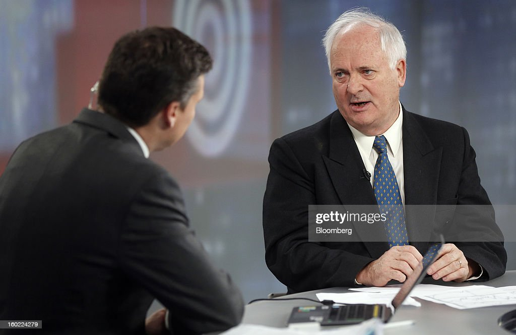 John Bruton, Ireland's former prime minister and current chairman of Ireland's International Financial Services Centre (IFSC), right, speaks during a Bloomberg Television interview in London, U.K., on Monday, Jan. 28, 2013. Euro-area jobless data this week will expose the social cost of last year's debt crisis and recession on southern European economies as unemployment across the region probably rose to a record in December. Photographer: Simon Dawson/Bloomberg via Getty Images