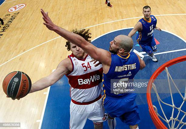 John Bryant #54 of FC Bayern Munich competes with James Augustine #5 of Khimki Moscow Region in action during the Turkish Airlines Euroleague Regular...