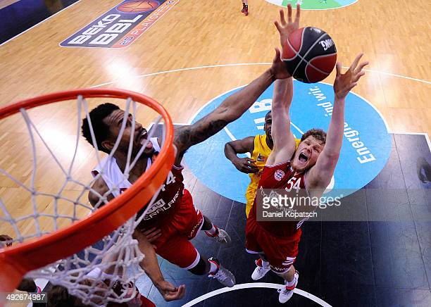 John Bryant of Muenchen fights for the ball during the Beko BBL Playoffs semifinal match between MHP RIESEN Ludwigsburg and FC Bayern Muenchen on May...