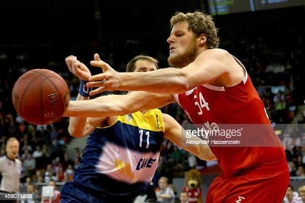 John Bryant of Muenchen is challenged by Adam Chubb of Oldenburg during the Beko Basketball Bundesliga match between FC Bayern Muenchen and EWE...