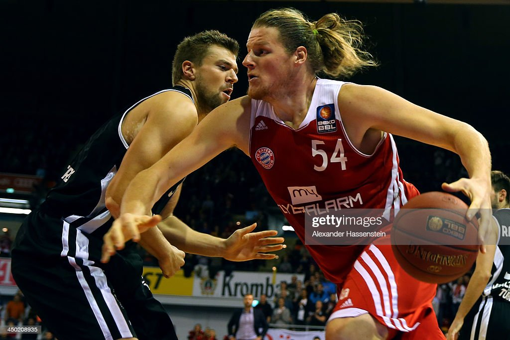 John Bryant (R) of Muenchen is challenged by Robert Ohle of Tuebingen during the Beko Basketball Bundesliga match between FC Bayern Muenchen and WALTER Tigers Tuebingen at Audi-Dome on November 17, 2013 in Munich, Germany.