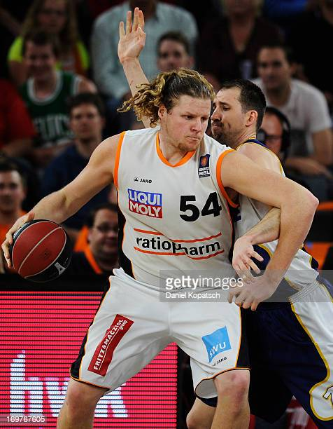 John Bryant of Ulm is challenged by Adam Chubb of Oldenburg during the fourth Game of the semifinals of the Beko Basketball Playoffs match between...