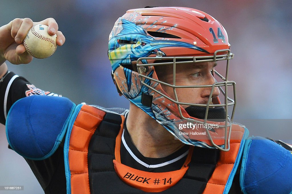 <a gi-track='captionPersonalityLinkClicked' href=/galleries/search?phrase=John+Buck&family=editorial&specificpeople=213730 ng-click='$event.stopPropagation()'>John Buck</a> #14 of the Miami Marlins throws to first base during the game against the Philadelphia Phillies at Citizens Bank Park on September 12, 2012 in Philadelphia, Pennsylvania. The Phillies won 3-1.