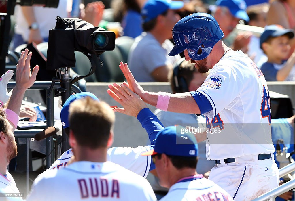 <a gi-track='captionPersonalityLinkClicked' href=/galleries/search?phrase=John+Buck&family=editorial&specificpeople=213730 ng-click='$event.stopPropagation()'>John Buck</a> #44 of the New York Mets is congratulated by teammates in the dugout after he scored in the seventh inning against the New York Mets on May 12, 2013 at Citi Field in the Flushing neighborhood of the Queens borough of New York City.